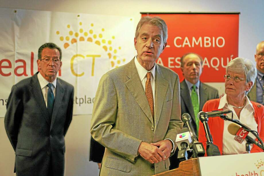 Access Health CT CEO Kevin Counihan speaks at a press conference. Gov. Dannel P. Malloy and Lt. Gov Nancy Wyman are behind him. Photo: File Photo
