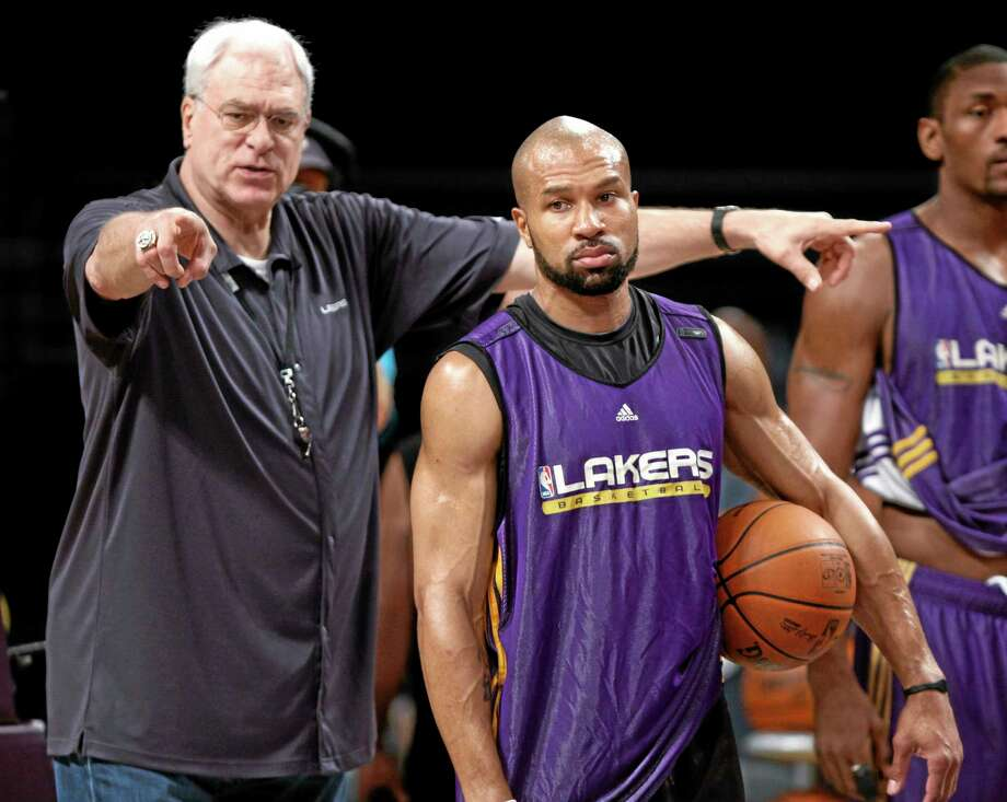 The New York Knicks have scheduled a news conference for Tuesday amid reports that Derek Fisher, right, has agreed to become the team's basketball head coach. Photo: The Associated Press File Photo  / AP