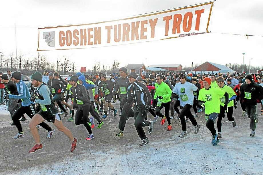 Hundreds of runners take off at the starting line of the 36th annual Goshen Turkey Trot. Photo: Matt DeRienzo—Register Citizen