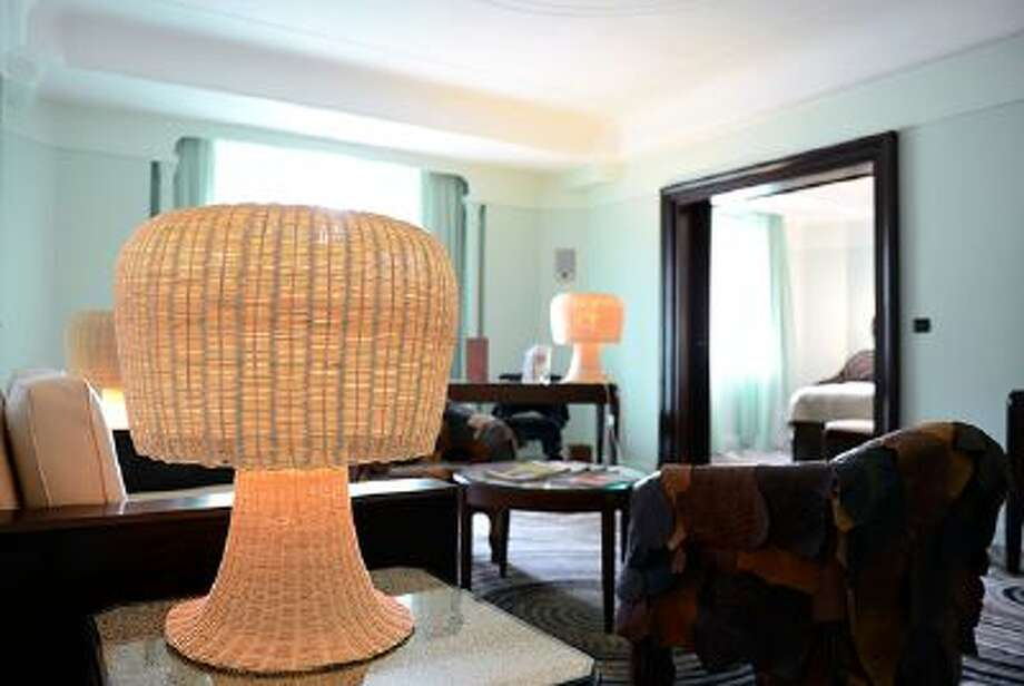 """A picture taken on September 2012 shows a lamp in the room designed by Brazilian brothers Fernando and Humberto Campana at the luxury hotel """"Lutetia"""" in Paris. The artists' unit transforms daily use materials into unique products such as furnitures, accesories or large-scaled installations.   AFP PHOTO / FRANCK FIFE        (Photo credit should read FRANCK FIFE/AFP/GettyImages) Photo: AFP/Getty Images / 2012 AFP"""