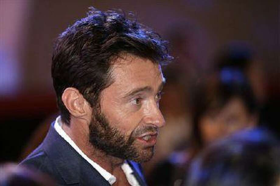 "Actor Hugh Jackman answers reporters' question during the premiere event of his new film ""The Wolverine"" in Seoul, South Korea, Monday, July 15, 2013. The movie is to be released in South Korea on July 25. (AP Photo/Lee Jin-man) Photo: AP / AP"