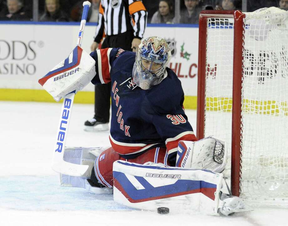 Goaltender Henrik Lundqvist deflects the puck during the first period of the Rangers' 5-2 win over the Philadelphia Flyers on Saturday at Madison Square Garden in New York. Photo: Bill Kostroun — The Associated Press  / FR51951 AP