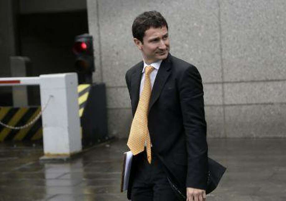 Fabrice Tourre leaves court during an afternoon break Monday, July 22, 2013 in New York. Tourre is a former Goldman Sachs trader accused of misleading other investors who lost a fortune by betting that investments would rise in value, while his fund bet against those same investments which were tied to high-risk mortgages. (AP Photo/Seth Wenig) Photo: AP / AP