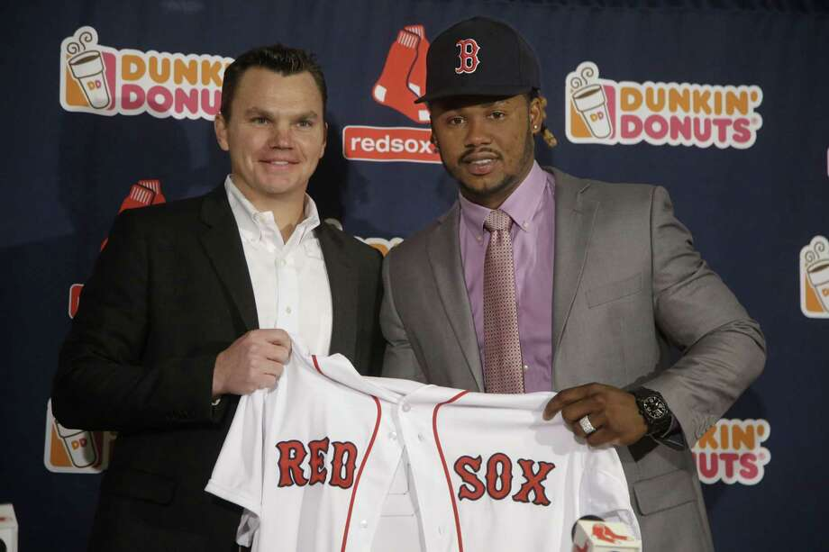 Newly acquired Boston Red Sox infielder Hanley Ramirez and general manager Ben Cherington pose for a photo on Tuesday at Fenway Park in Boston. Register sports columnist Chip Malafronte points out the Red Sox have been spending and the Blue Jays have been dealing while the Yankees, saddled with awful contracts, are sitting tight. Photo: Stephan Savoia — The Associated Press  / AP