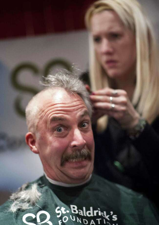 Fire departments from across the region gathered at O'Toole's on Orange Street in New Haven Friday to have their heads shaved to raise more than $35,000 at a St. Baldrick's event to fight childhood cancers.  V.M. Williams