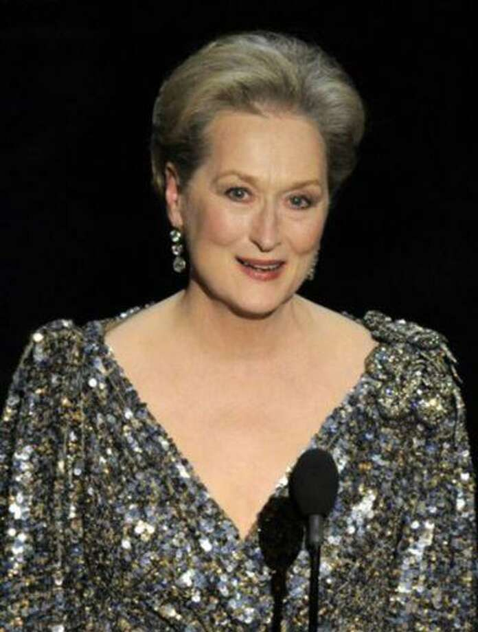"""FILE - In a Feb. 24, 2013, file photo Meryl Streep appears at the Oscars at the Dolby Theatre in Los Angeles. John Wells' """"August: Osage County,"""" which stars Meryl Streep and Julia Roberts, is among the 16 galas at the Toronto Film Festival , it was announced Tuesday, July 24, 2013. (Photo by Chris Pizzello/Invision/AP, file) Photo: Chris Pizzello/Invision/AP / Invision"""