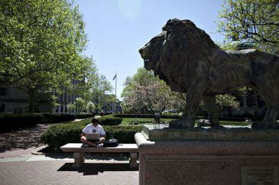 Columbia University charges $7,736 for its three-week summer program. Summer courses for high school students have become a lucrative business for elite colleges. Shown, the Scholar's Lion sculpture on campus in New York in 2010. Illustrates COLLEGE-SUMMER (category a) by Mary Camille Izlar &Copy; 2013, Bloomberg News. Moved Wednesday, July 17, 2013. (MUST CREDIT: Bloomberg News photo by Daniel Acker). Photo: BLOOMBERG / BLOOMBERG