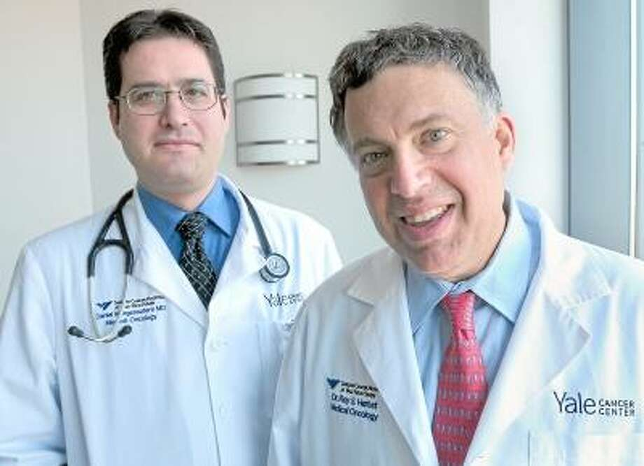 Photo by Arnold Gold/New Haven Register Dr. Daniel Morgensztern (left), assistant professor of Medical Oncology, and Dr. Roy Herbst, Chief of Medical Oncology, are photographed at Smilow Cancer Hospital at Yale-New Haven in New Haven.
