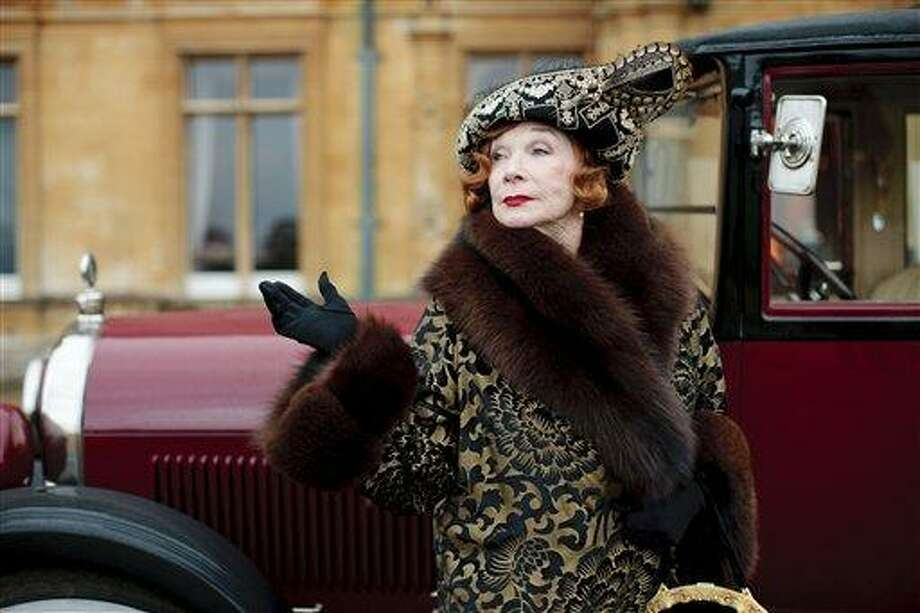 """This undated publicity photo provided by PBS shows Shirley MacLaine as Martha Levinson from the TV series, """"Downton Abbey."""" Carnival Films and MASTERPIECE on PBS today announced that six new cast names are joining the series plus the return of Shirley MacLaine for next season's finale.  The Hollywood star, who reprises her role as Martha Levinson, proved a huge hit with viewers last year. (AP Photo/PBS, Carnival Film & Television Limited 2012 for MASTERPIECE, Nick Briggs) Photo: AP / PBS"""