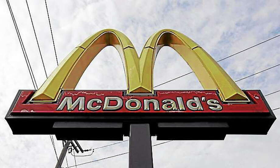 FILE - This Friday, Oct. 4, 2013, file photo, shows a McDonald's restaurant sign at a McDonald's restaurant in Chicago. McDonald's Corp. said Friday, Nov. 8, 2013, that a key revenue figure edged up 0.5 percent in October, as the world's biggest hamburger chain's better results in the U.S. and Europe offset a decline in Asia. (AP Photo/Nam Y. Huh, File) Photo: Journal Register Co.