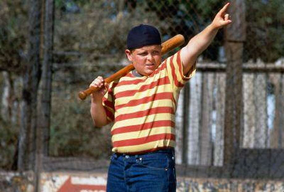 """This film image released by 20th Century Fox shows Patrick Renna as Hamilton """"Ham"""" Porter in a scene from the 1993 film """"The Sandlot."""" The iconic film is celebrating it's 20th anniversary. Members of the cast and crew are returning to Utah for events on July 19-20, including an outdoor screening of the movie at Spring Mobile Ballpark. (AP Photo/20th Century Fox) Photo: AP / 20th Century Fox"""