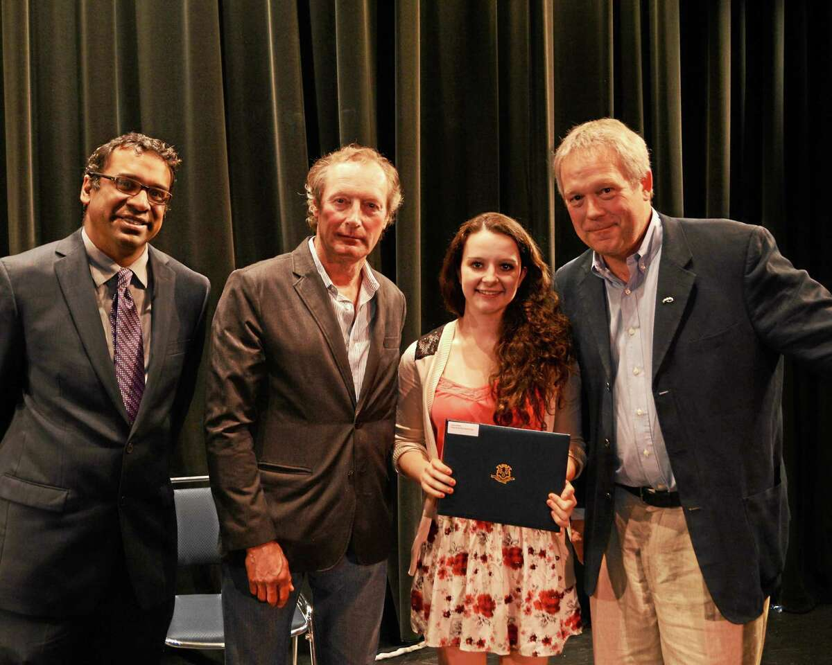 Contributed Photo (From left) Trust Chairman Ravi Shankar; keynote speaker Michael White, second place prose winner Selena West and Trust Vice Chairman Rand Cooper.