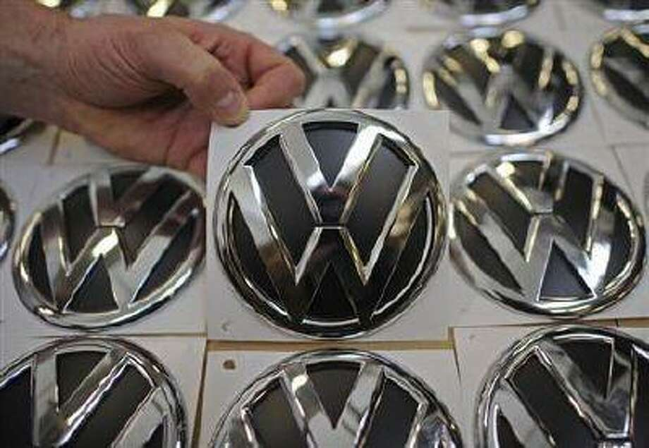 VW emblems are presented in a production line at the plant of German carmaker Volkswagen in Wolfsburg, March 7, 2012. (REUTERS/Fabian Bimmer)