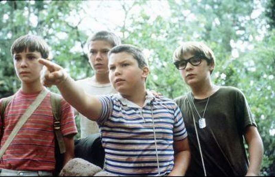 "ADV. FOR IMMEDIATE RELEASE--FILE--Jerry O'Connell points in a scene from the 1986 movie, ""Stand By Me."" Fromleft, Wil Wheaton, River Phoenix, O'Connell and Corey Feldman. O'Connell, now a slimmed-down, bulked-up 22-year-old, currently stars in the movie, ""Joe's Apartment."" (AP Photo/Universal Films) Photo: AP / COLUMBIA PICTURES"