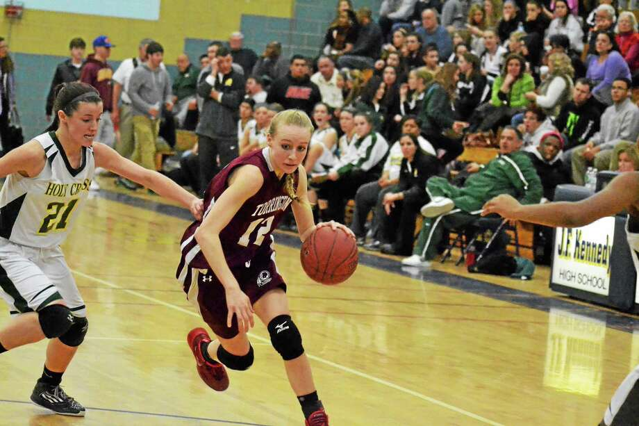 Torrington's Paige Middleton drives to the basket against Holy Cross. The Crusaders won the game 50-41 over the Red Raiders and clinched a spot in the NVL title game. Photo: Pete Paguaga — Register Citizen