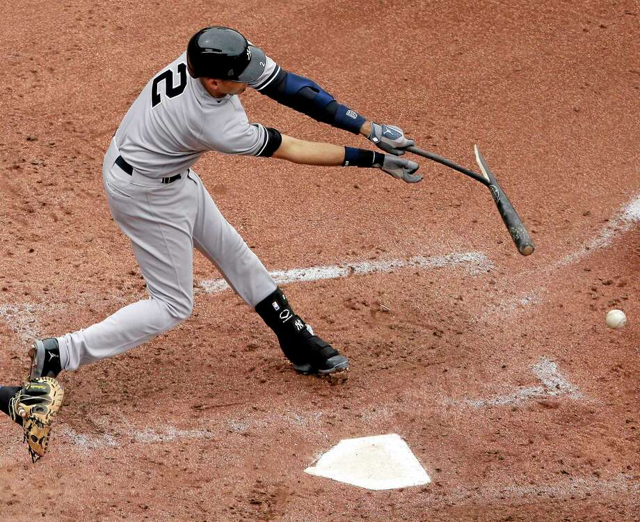 The Yankees' Derek Jeter breaks his bat as he grounds out during the seventh inning against the Royals on Sunday. Photo: Charlie Riedel — The Associated Press  / AP