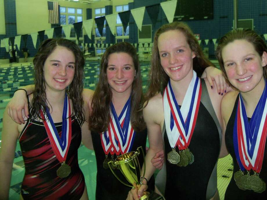 Northwestern relay team, from left, Mollie Traub; Olivia Morris; Kiley Stotler; Rachael Pulica set a record en route to their first championship since 1997. Photo by Peter Wallace/Register Citizen