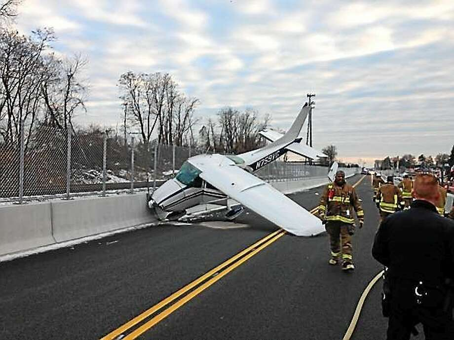A single-engine plane made an emergency landing on the CTFastrak busway on New Park Avenue in West Hartford November 29, 2014. Photo: (From Hartford Police Deputy Chief Brian J. Foley, @LtFoley On Twitter)