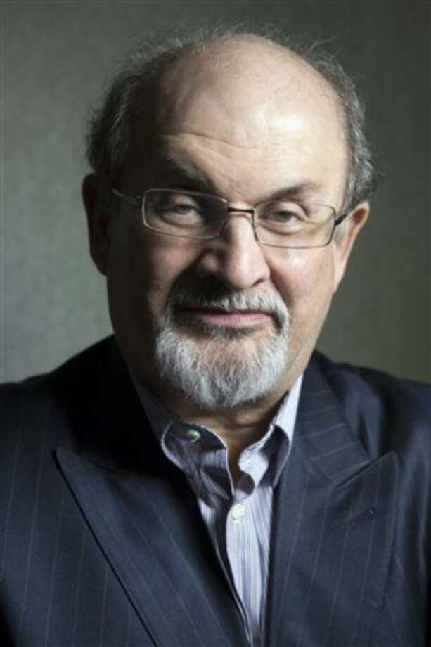 "File-This Sept. 8, 2012 file photo shows author Salman Rushdie posing for a photo as he promotes the movie ""Midnight's Children"" during the 2012 Toronto International Film Festival in Toronto. Put Rushdie, Martin Amis and Ian McEwan on a stage and expect a night of high art and school boy humor, of reading, writing and Christopher Hitchens. (AP Photo/The Canadian Presss, Chris Young, File) Photo: AP / The Canadian Press"
