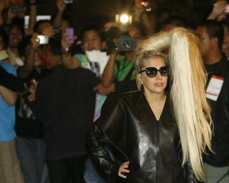 U.S. singer Lady Gaga poses for photographers upon arrival for her concert in Manila May 19, 2012. REUTERS/Cheryl Ravelo / X01683