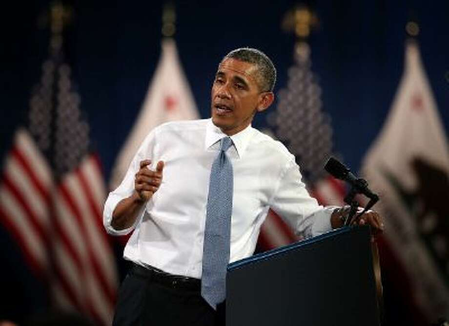President Barack Obama addresses a heckler during a speech at the Betty Ann Ong Chinese Recreation Center on November 25, 2013 in San Francisco, California. Photo: Getty Images / 2013 Getty Images