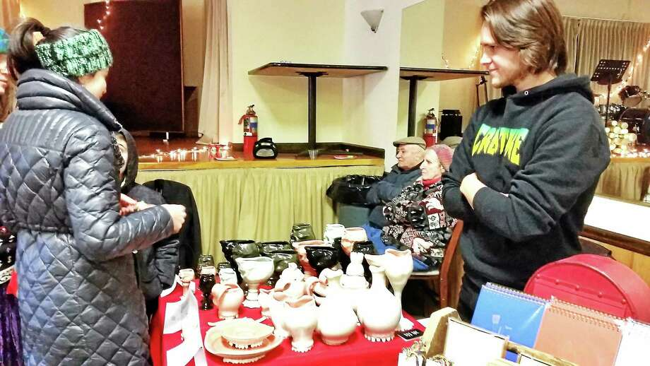 Sculptor Dan Roe of Roedkill Ceramics displays his pottery, ornamented with depicted human teeth and tongues, at the second annual Torrington Makers Market on Saturday afternoon at the Knights of Columbus in Torrington. Photo: N.F. Ambery — Special To The Register Citizen