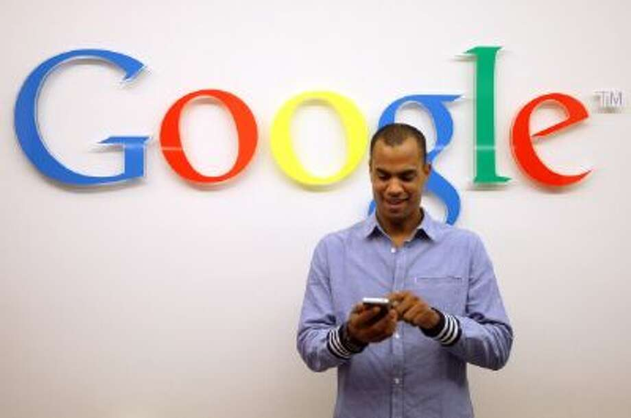 A visitor uses a cell phone in front of the Google logo on September 26, 2012 at the official opening party of the Google offices in Berlin, Germany. Photo: Getty Images / 2012 Getty Images