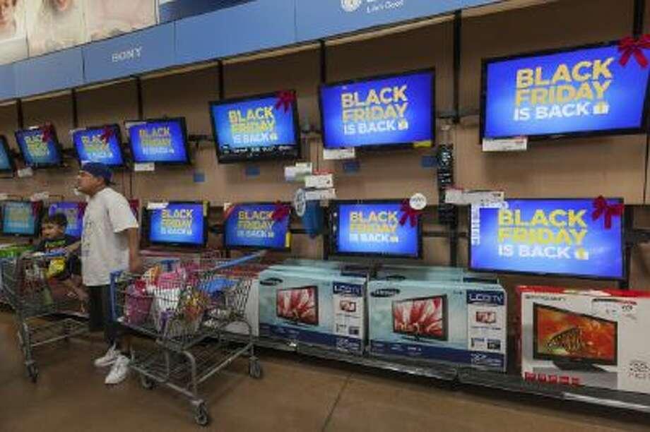 Shoppers look for deals at a 2012 Pre-Black Friday event at a California Walmart Supercenter.