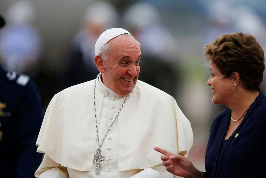 Brazil's President Dilma Rousseff and Pope Francis visit upon his arrival at the international airport in Rio de Janeiro, Brazil, Monday, July 22, 2013, in his first trip as pontiff to Latin America. Francis, the 76-year-old Argentine who became the church's first pontiff from the Americas in March, returns to the embrace of Latin America to preside over the Roman Catholic Church's World Youth Day festival. (AP Photo/Jorge Saenz) Photo: AP / AP