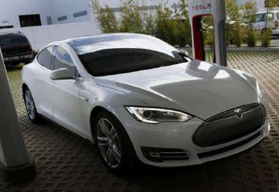 A Tesla Model S Roadster vehicle is charged at company's design studio in Hawthorne, California, July 31.