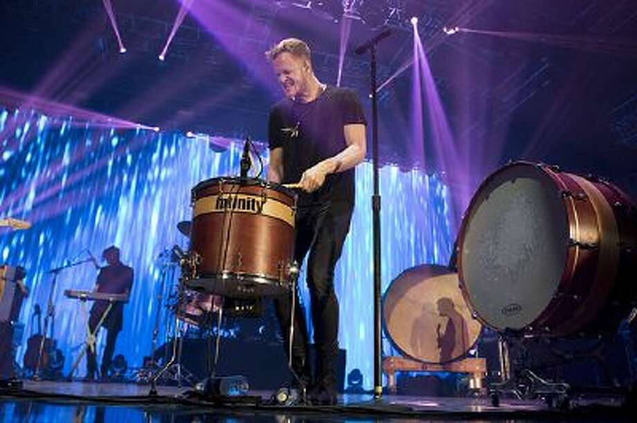 """FILE - In this Jan. 31, 2014 file photo, Dan Reynolds of Imagine Dragons performs at The Bud LIght Hotel, in New York. Imagine Dragons set a record last week on the Billboard Hot 100 with the anthemic rock jam, """"Radioactive,"""" which has spent 77 weeks - and counting - on the chart.  (Photo by Greg Allen/Invision/AP, file) Photo: Greg Allen/Invision/AP / Invision"""