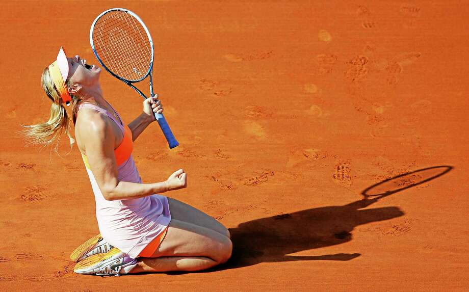 Maria Sharapova reacts after defeating defending New Haven Open champion Simona Halep during the final of the French Open Saturday at the Roland Garros stadium in Paris. Sharapova won 6-4, 6-7, 6-4. Photo: David Vincent — The Associated Press  / AP