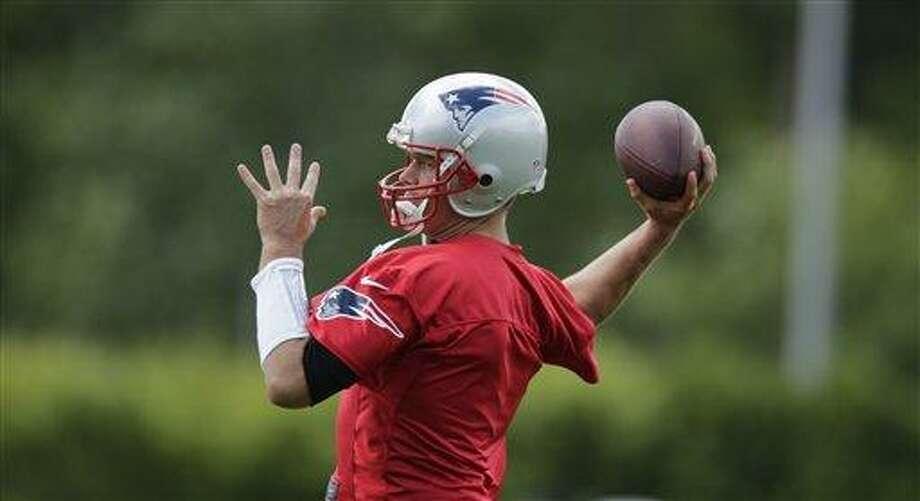 New England Patriots quarterback Tom Brady during a team football practice in Foxborough, Mass., Wednesday June 12, 2013. (AP Photo/Charles Krupa) Photo: AP / AP