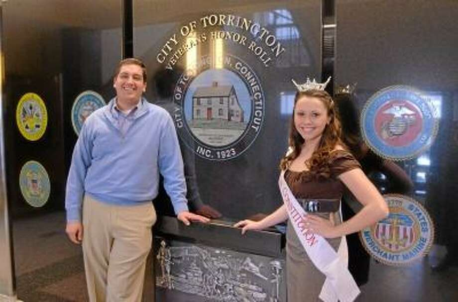 Miss Constitution, Molly Westfall talks with Torrington Mayor Ryan Bingham at the veterans memorial in city hall on Friday. Westfall is asking the mayor for help with her projects to help veterans in the area. John Berry/Register Citizen.