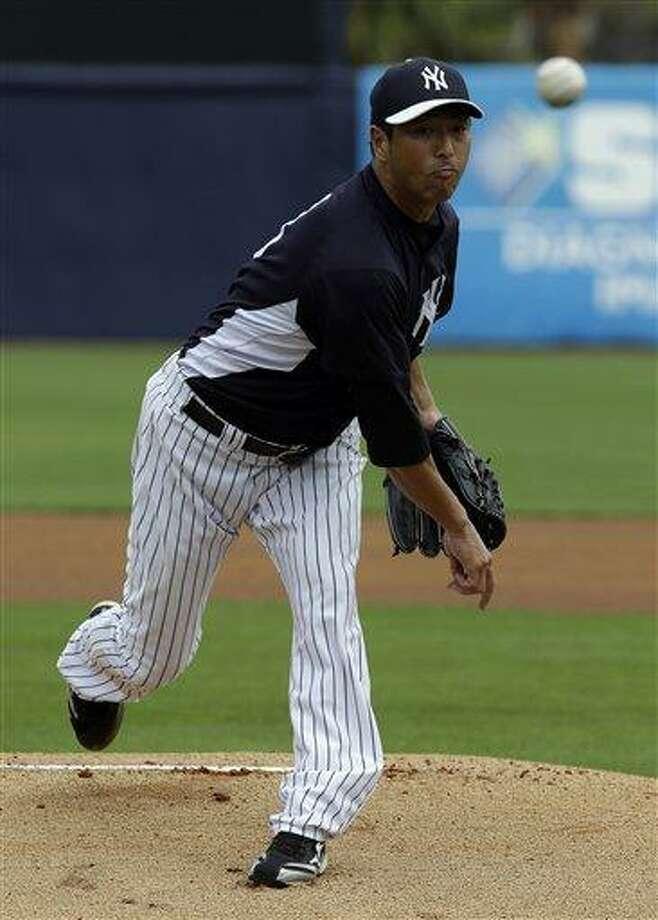 New York Yankees pitcher Hiroki Kuroda, of Japan, delivers to the Philadelphia Phillies during a MLB spring training baseball game Friday, March 1, 2013, in Tampa, Fla. (AP Photo/Chris O'Meara) Photo: ASSOCIATED PRESS / AP2013