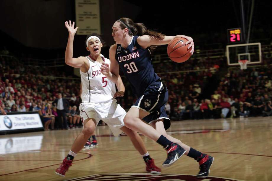 UConn forward Breanna Stewart, right, dribbles next to Stanford forward Kaylee Johnson during the Huskies' loss to the Cardinal on Nov. 17 in Stanford, Calif. Photo: Marcio Jose Sanchez — The Associated Press  / AP