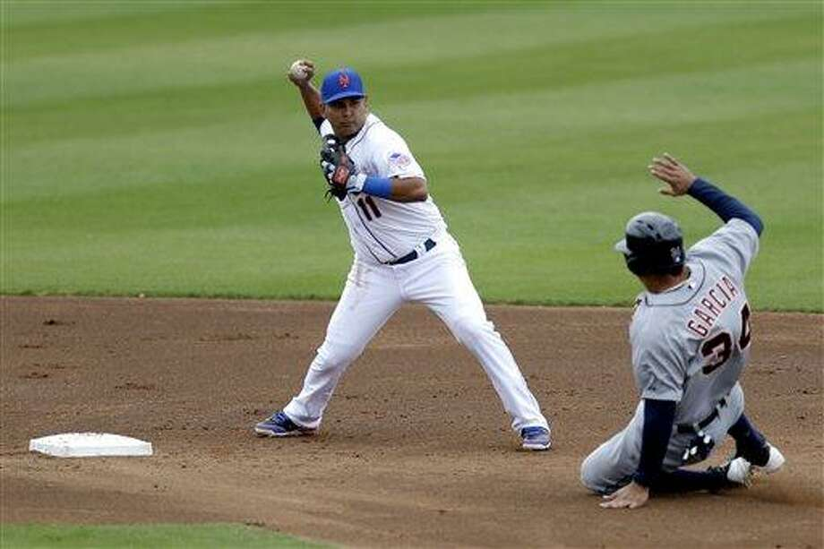 New York Mets shortstop Ruben Tejada, left, turns a double play as Detroit Tigers' Brandon Lyon slides in during the third inning of an exhibition spring training baseball game, Friday, March 1, 2013, in Port St. Lucie, Fla.  (AP Photo/Julio Cortez) Photo: ASSOCIATED PRESS / AP2013