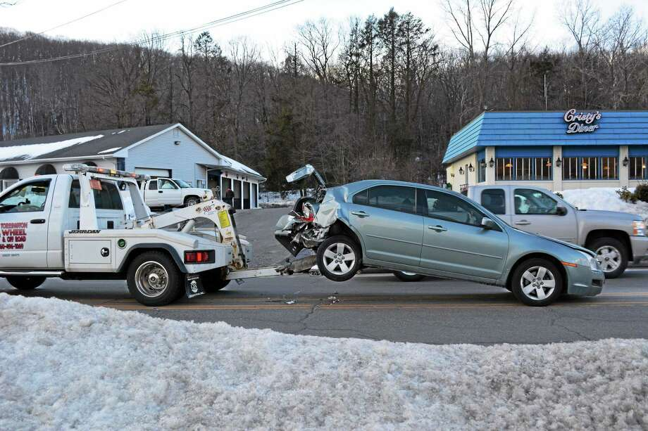The scene of a two-car accident that brief closed a portion of Winsted Road in Torrington Monday. Photo: Jenny Golfin—Register Citizen