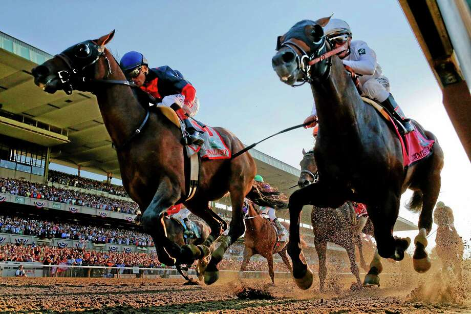 Tonalist, left, with Joel Rosario up edges out Commissioner, with Javier Castellano up, to win the 146th running of the Belmont Stakes Saturday in New York. Photo: Matt Slocum — The Associated Press  / AP