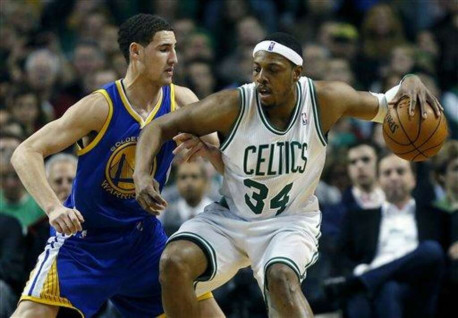 Boston Celtics' Paul Pierce (34) looks to move against Golden State Warriors' Klay Thompson during the third quarter of an NBA basketball game in Boston, Friday, March 1, 2013. The Celtics won 94-86. (AP Photo/Michael Dwyer) Photo: ASSOCIATED PRESS / AP2013