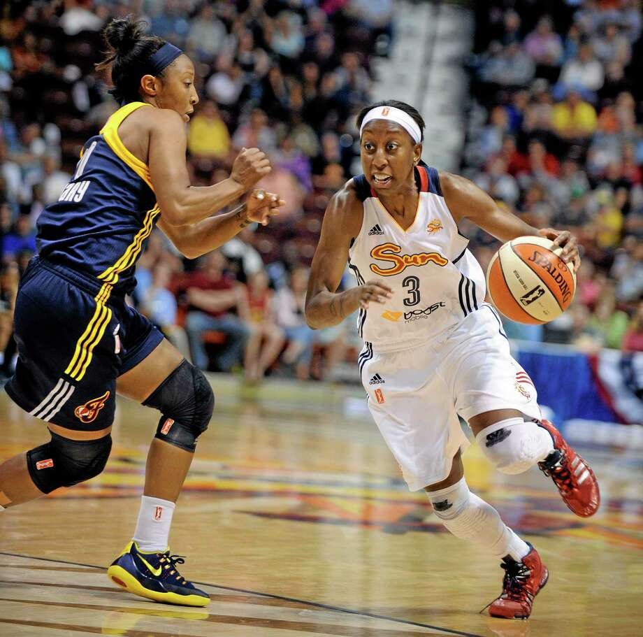The Connecticut Sun's Allison Hightowerm right, drives past the Fever's Briann January during Saturday's game. Photo: Fred Beckham — The Associated Press  / FR153656 AP