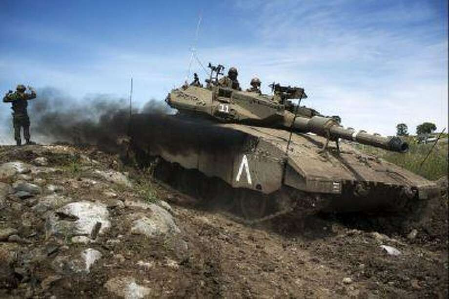 An Israeli Merkava tank maneuvers during a drill in the Israeli annexed Golan Heights near the border with Syria on April 24. Israel's Brigadier General Itai Brun, head of research and analysis in the army's military intelligence division, said that the Damascus regime was guilty of using chemical weapons against rebel fighters.