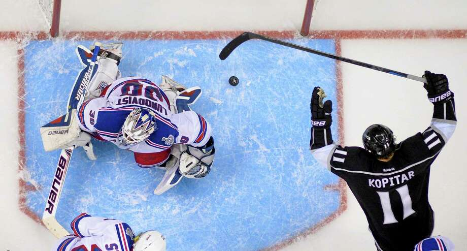 Los Angeles Kings center Anze Kopitar celebrates Marian Gaborik's goal past Rangers goalie Henrik Lundqvist during the third period Saturday. Photo: Mark J. Terrill — The Associated Press  / AP