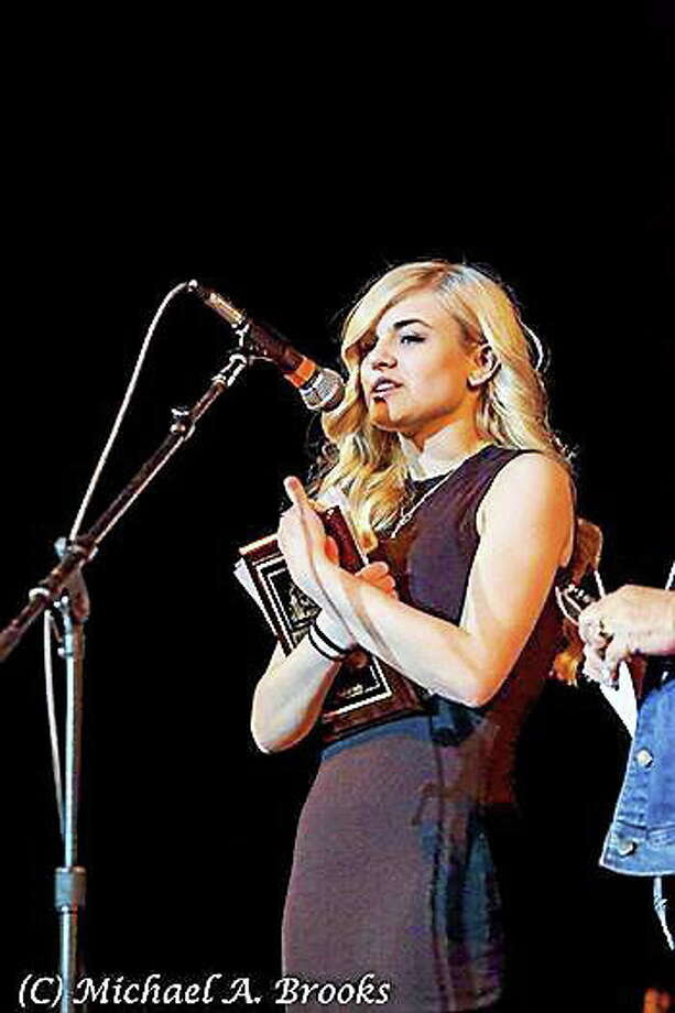 (Submitted Photo by Michael A. Brooks Photography) Sarah accepting the award for Best New Act at the New England Music Awards. Photo: Journal Register Co.