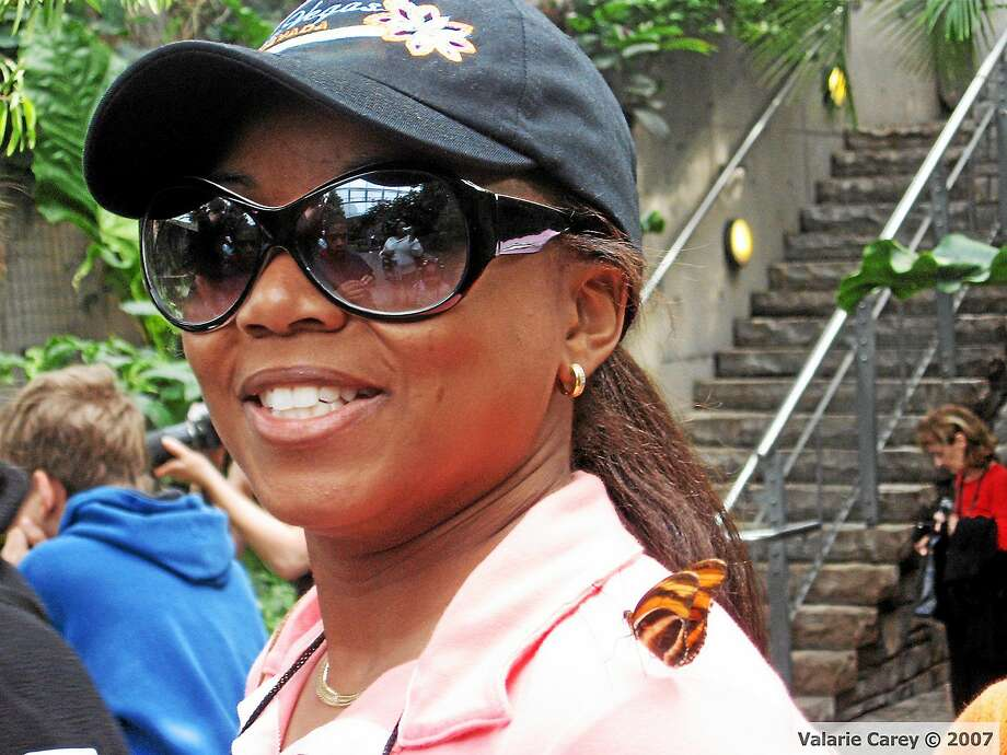 A butterfly lands on Miriam Carey on a 2007 trip to a conservatory near Niagara Falls. Photo: Contributed Photo — Valarie Carey  / THE WASHINGTON POST