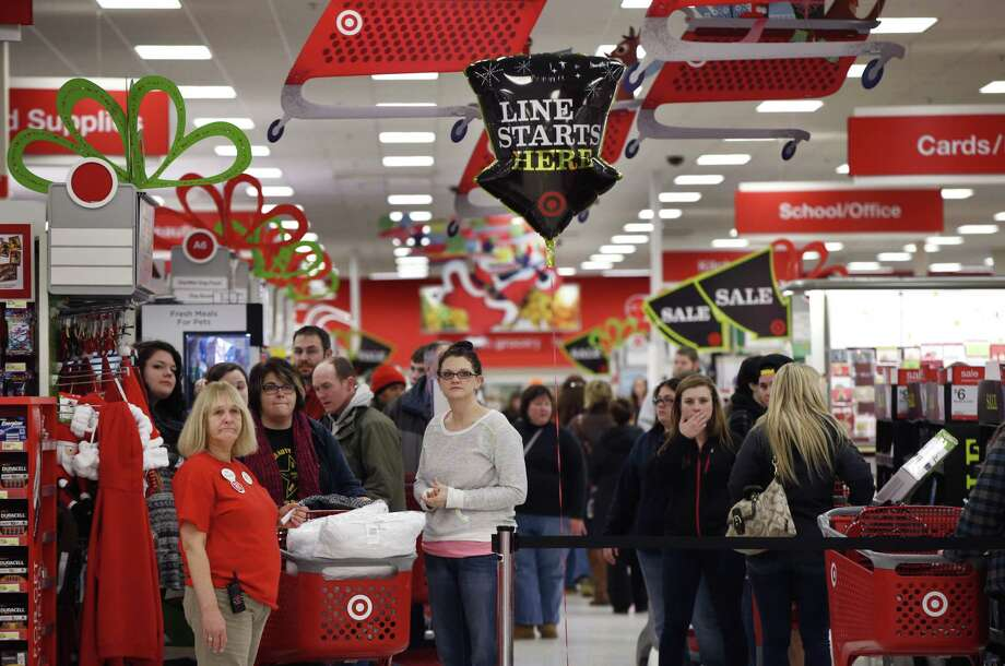 Target shoppers wait to check out on Black Friday, Nov. 28, 2014, in South Portland, Maine. The store opened at midnight. (AP Photo/Robert F. Bukaty) Photo: AP / AP
