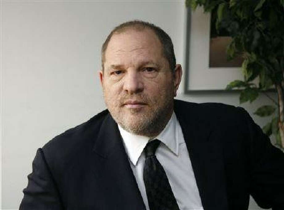 "FILE - In this Nov. 23, 2011 file photo, Harvey Weinstein, film producer and co-chairman of The Weinstein Company, is shown in New York. The dustup over the rights to a film title has turned into a public squabble between Weinstein and Warner Bros. Disputed is the claim to the title ""The Butler,"" which the Weinstein Co. has promoted as the name of an upcoming drama about a White House butler. Weinstein took to ""CBS This Morning"" on Tuesday, July 9, 2013, to claim Warner Bros. has an ""ulterior motive"" in refusing to allow use of the title. (AP Photo/John Carucci, File) Photo: AP / AP"