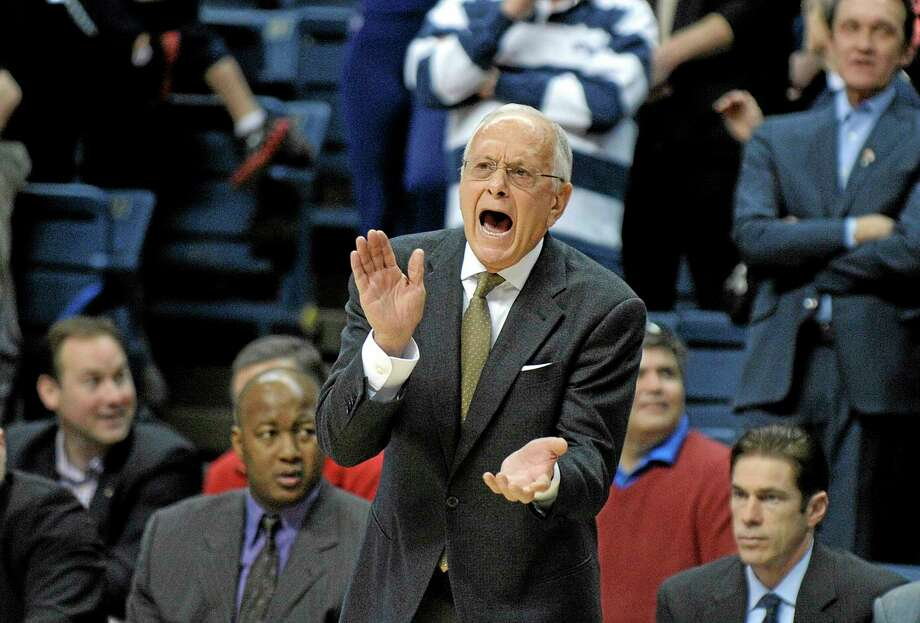 SMU head coach Larry Brown encourages his team during the first half of SMU's 64-55 victory over UConn Sunday in Storrs. Photo: Fred Beckham — The Associated Press  / FR153656 AP
