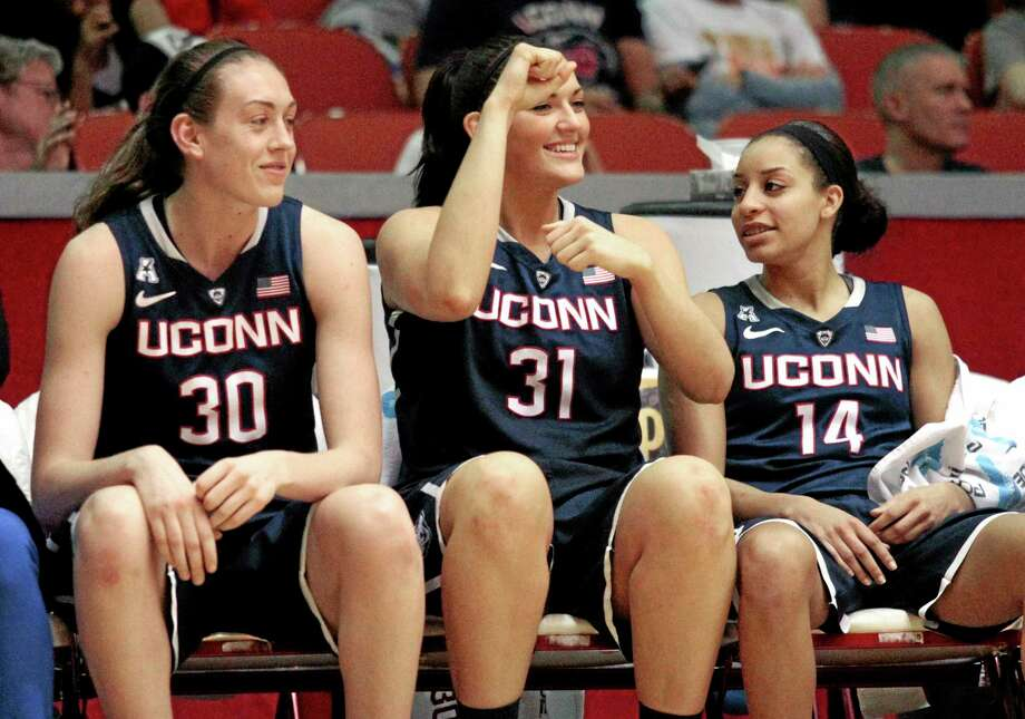 UConn sophomore Breanna Stewart, left, cheers from the bench with seniors Stefanie Dolson, center, and Bria Hartley during Saturday's win over Houston. Photo: Patric Schneider — The Associated Press  / FR170473 AP