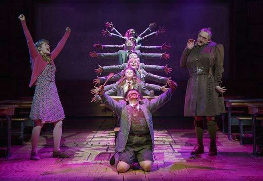 "This theater publicity image released by Boneau/Bryan-Brown shows the cast of ""Matilda The Musical,"" including Bertie Carvel, right, and Lauren Ward, left, during a performance in New York. (AP Photo/Boneau/Bryan-Brown, Joan Marcus) Photo: AP / Boneau/Bryan-Brown"